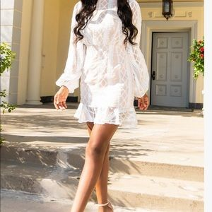 White lace dress from Pretty Little Thing.